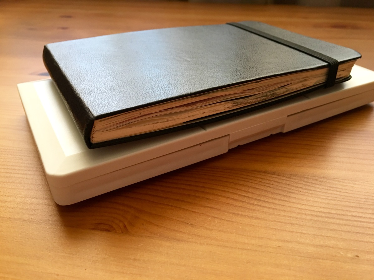 Grace Art watercolor palette with Moleskine Art Plus pocket watercolor journal on top