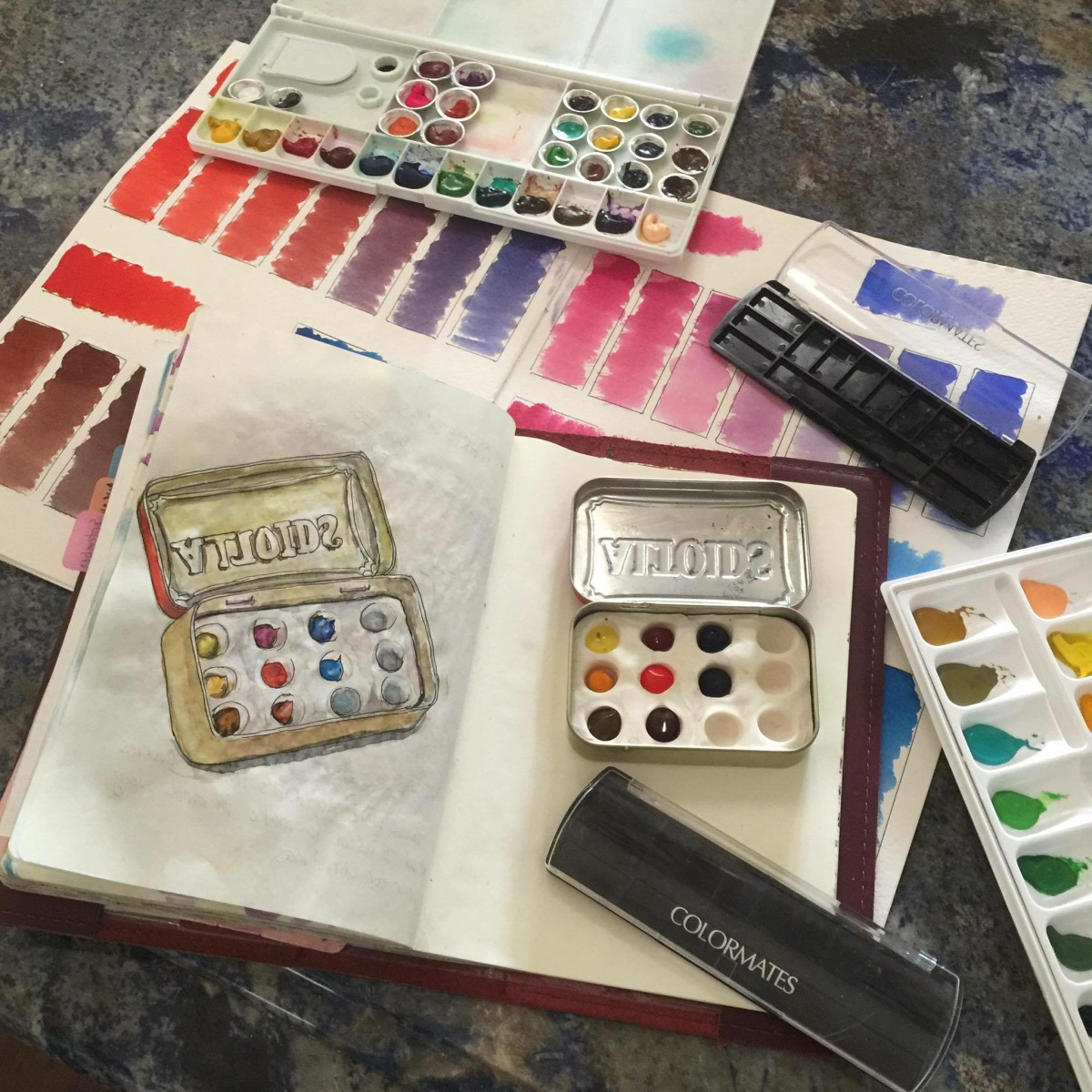 Altoids travel tin with Sculpey clay inside and other homemade watercolour palettes