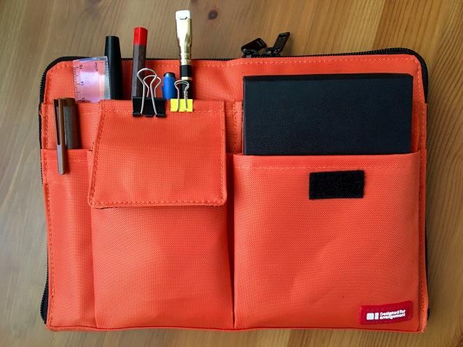 Orange Lihit Teffa Ban in Bag with Grace Art Watercolor field box, Moleskine, pencils and pens inside