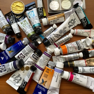 Supplies - many paint tubes of watercolor paints on Doodlewash