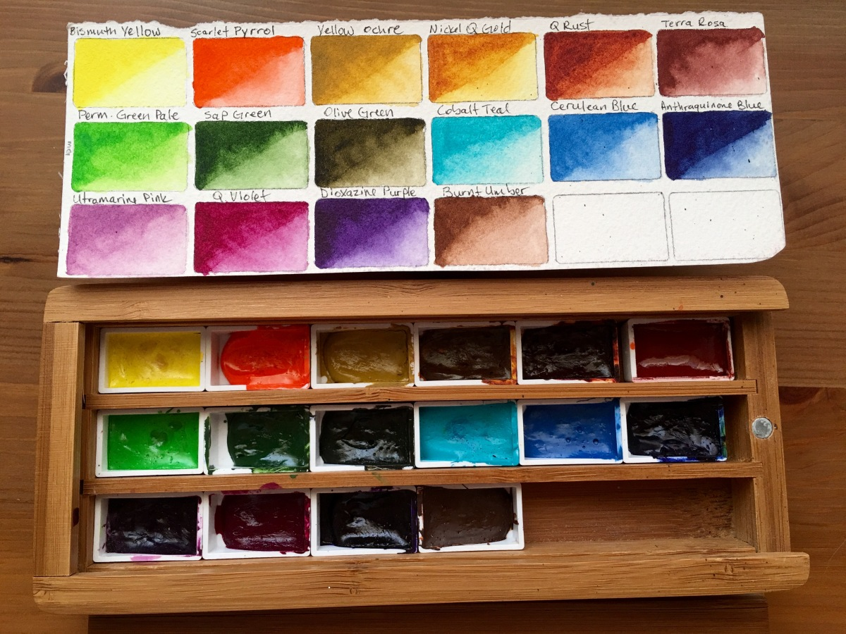 Palette half pans of watercolor paint M. Graham and swatches on Doodlewash