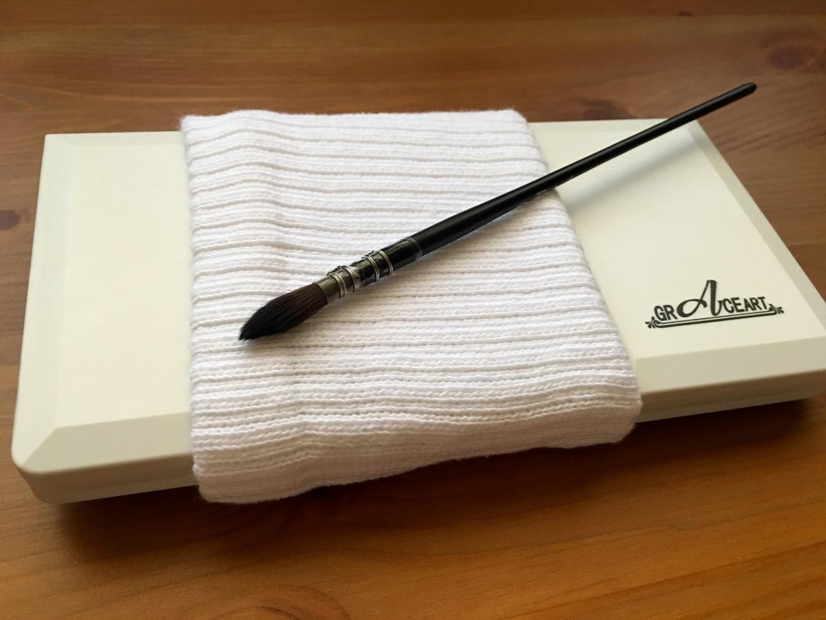 Tube sock around Grace Art travel watercolor palette and paint brush