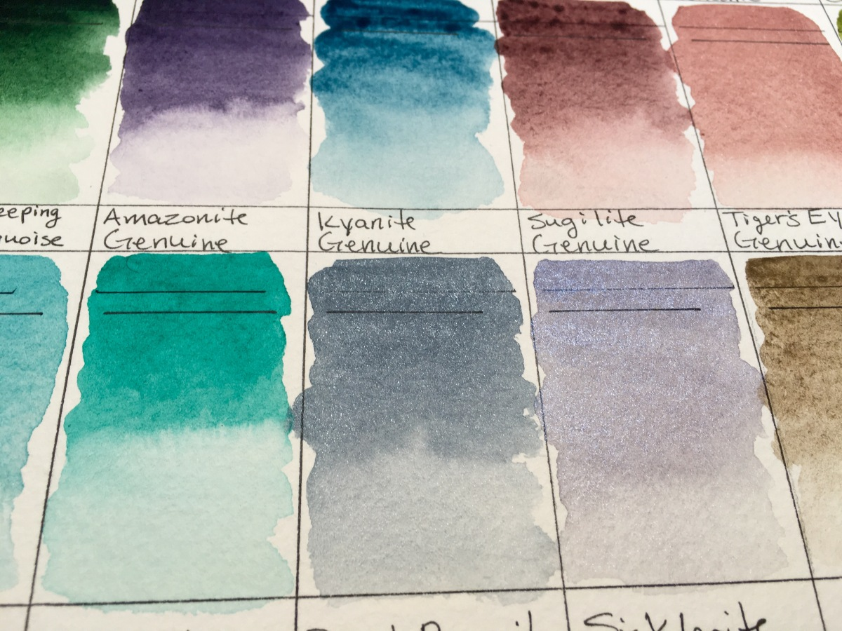 Daniel Smith PrimaTek watercolors swatches on Strathmore 400 series watercolor paper amazonite Genuine, kyanite genuine, sugilite genuine