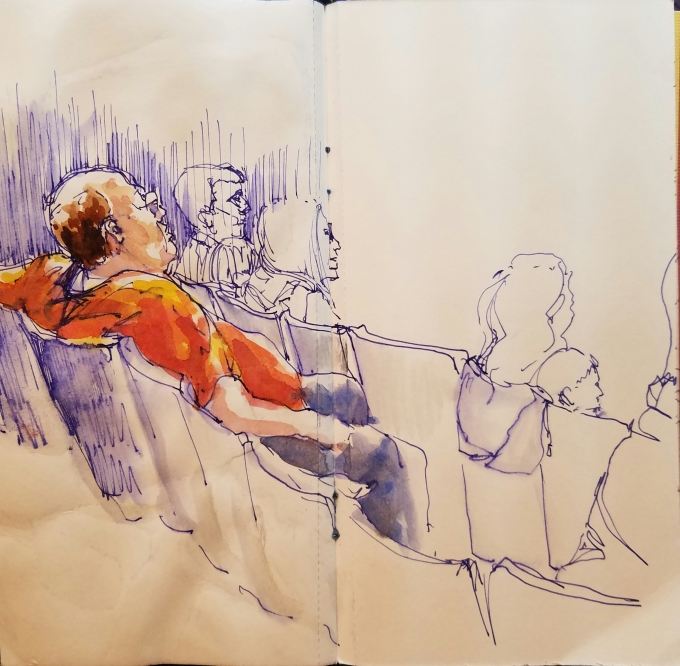 Doodlewash by Urban Sketcher Suzala of man watching presentation