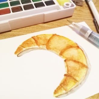 #WorldWatercolorGroup - watercolor sketch by Keiko Weafer Japan of croissant - #doodlewash